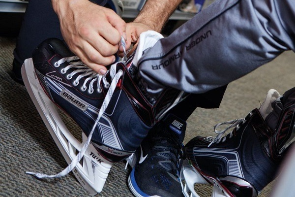 Putting on the Bauer hockey skates.